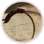 Flyboarder Doing Back Flip Over Backlit Waves Round Beach Towel