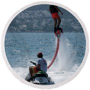 Flyboarder In Pink Shorts Above Jet Ski Round Beach Towel