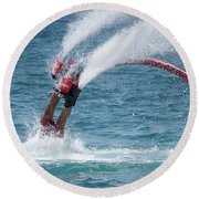 Flyboarder In Red Entering Water With Spray Round Beach Towel