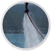 Flyboarder In Silhouette Balancing High Above Water Round Beach Towel