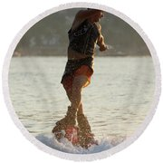 Flyboarder Twisting Upper Body Just Above Waves Round Beach Towel
