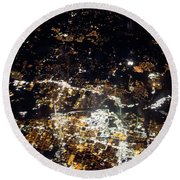 Flying At Night Over Cities Below Round Beach Towel