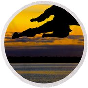 Flying Kick Over Muskegon Lake Round Beach Towel
