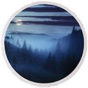Fog Around The Mountain Top At Night Round Beach Towel