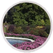 Fountain And Mums Round Beach Towel