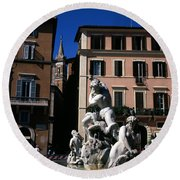 Fountain Depicting Neptune The Piazza Navona The Spire Of The Church Of Santa Maria Della Pace Rome Round Beach Towel
