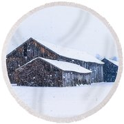 Four Barns In A Snowstorm Round Beach Towel
