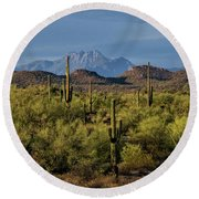 Four Peaks On The Horizon  Round Beach Towel