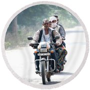 Four People On A Motorbike Round Beach Towel
