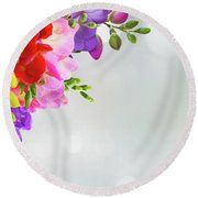 Fresh Freesia Flowers On Blue Round Beach Towel