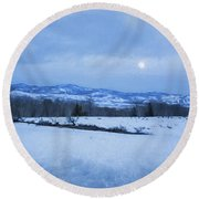 Full Moon Over A Field Of Snow Round Beach Towel