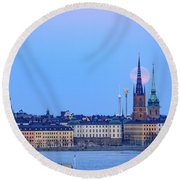 Full Moon Rising Over Gamla Stan Churches In Stockholm Round Beach Towel