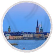 Full Moon Rising Over The Trio Of Gamla Stan Churches In Stockholm Round Beach Towel