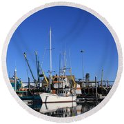 Glassy Harbor Reflection Round Beach Towel