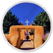 gate of church in Ranchos Round Beach Towel