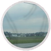 Gazing At A Scenic Amish Vista Round Beach Towel