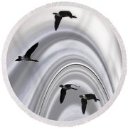 Geese In A Halo Round Beach Towel
