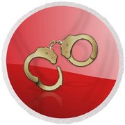 Gold Handcuffs On Red Round Beach Towel