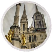 Golden Angel Statues In Front Of The Cathedral Round Beach Towel