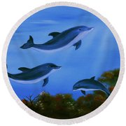 Graceful Dolphins At Play. Round Beach Towel