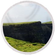 Grass Fields Surrounding The Cliff's Of Moher Round Beach Towel