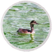 Grebe On Green Water Round Beach Towel