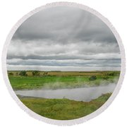 Green Landscape With Steamy River Round Beach Towel