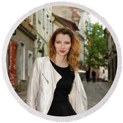 Grinning Attractive Woman Standing On Cobblestone Street Of Uppe Round Beach Towel