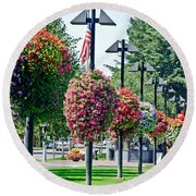 Hanging Flower Baskets In A Park Round Beach Towel