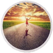 Happy Woman Jumping On Long Straight Road Round Beach Towel