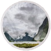 Heads In The Clouds Panorama At Milford Sound Round Beach Towel