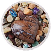 Heart Stone Among River Stones Round Beach Towel