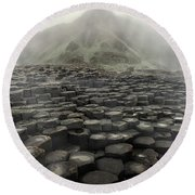 Hexagon Stones And A Mountain In The Morning Fog Round Beach Towel