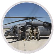 Hh-60g Pave Hawk With Pararescuemen Round Beach Towel
