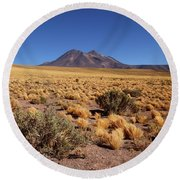 High Altitude Puna Grasslands And Miniques Volcano Chile Round Beach Towel