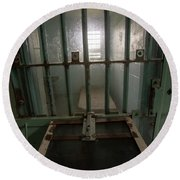 High Risk Solitary Confinement Cell In Prison Through Bars Round Beach Towel