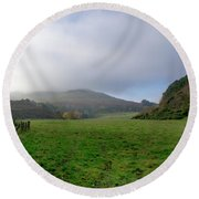 Hill Tops In Mist. Round Beach Towel