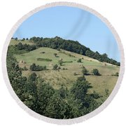 Hill With Haystack And Trees Landscape Round Beach Towel