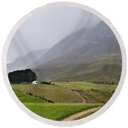House On A Hill In The Mist Round Beach Towel