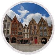 Houses Of Jan Van Eyck Square In Bruges Belgium Round Beach Towel