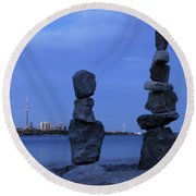 Human Figures Made From Stones At Night Round Beach Towel