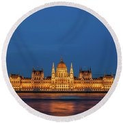 Hungarian Parliament Building At Night In Budapest Round Beach Towel