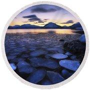 Ice Flakes Drifting Against The Sunset Round Beach Towel by Arild Heitmann