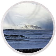 Iceland Lava Field Mountains Clouds Iceland Lava Field Mountains Clouds Iceland 2 282018 1837.jpg Round Beach Towel