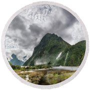 Impressive Weather Conditions At Milford Sound Round Beach Towel