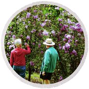 In The Lilac Garden Round Beach Towel