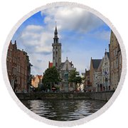 Jan Van Eyck Square With The Poortersloge From The Canal In Bruges Round Beach Towel