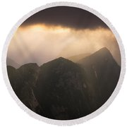 Sun Shining Through The Storm Clouds In The Mountains Round Beach Towel