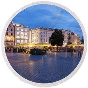 Krakow Main Square By Night Round Beach Towel