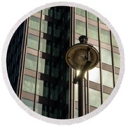 Lamp Post Against Green Glass Building Round Beach Towel